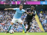 Kyle Walker and Jeffrey Schlupp in action during the Premier League game between Manchester City and Crystal Palace on September 23, 2017