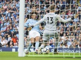Leroy Sane scores past Wayne Hennessey during the Premier League game between Manchester City and Crystal Palace on September 23, 2017