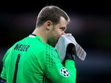 Bayern Munich goalkeeper Manuel Neuer in action for his side during a Champions League match against Arsenal