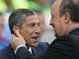 Rafael Benitez cleans Chris Hughton's ears during the Premier League game between Brighton & Hove Albion and Newcastle United on September 24, 2017