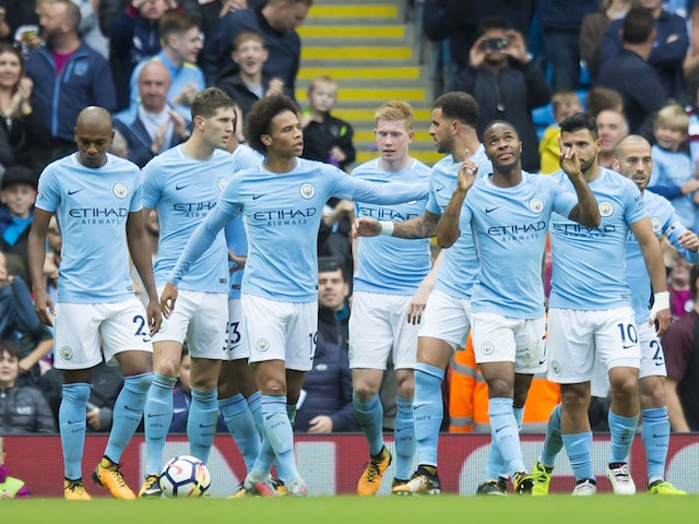 Raheem Sterling celebrates with teammates after scoring during the Premier League game between Manchester City and Crystal Palace on September 23, 2017