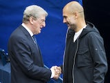 Roy Hodgson and Pep Guardiola shake hands ahead of the Premier League game between Manchester City and Crystal Palace on September 23, 2017