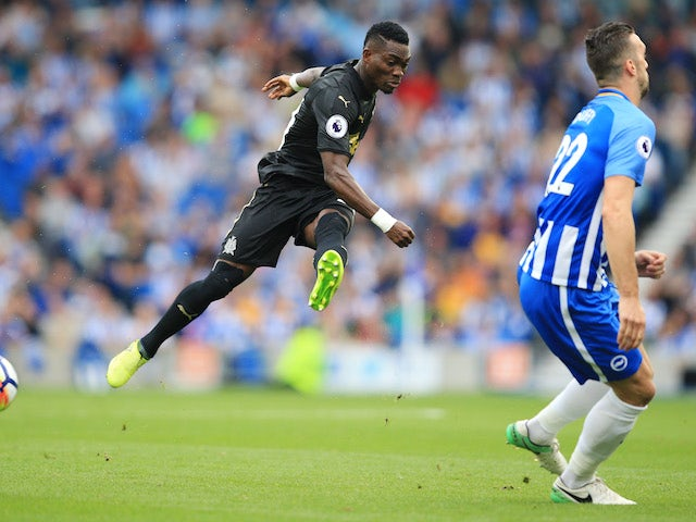 Shane Duffy and Christian Atsu in action during the Premier League game between Brighton & Hove Albion and Newcastle United on September 24, 2017