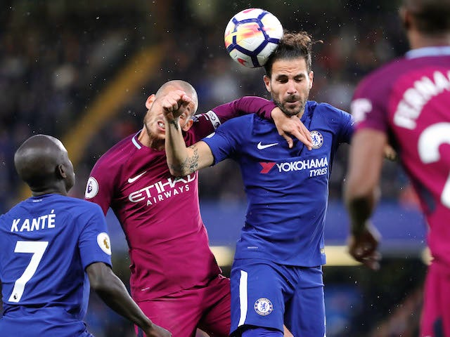 Cesc Fabregas beats David Silva to a header during the Premier League game between Chelsea and Manchester City on September 30, 2017