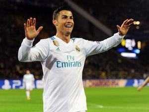Cristiano Ronaldo celebrates scoring during the Champions League game between Borussia Dortmund and Real Madrid on September 26, 2017