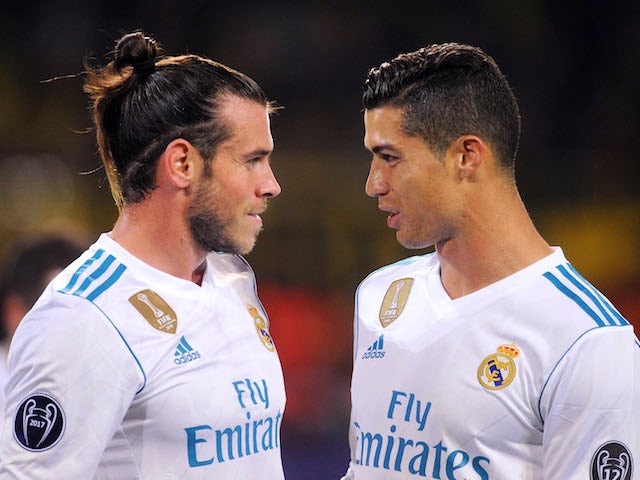 Gareth Bale and Cristiano Ronaldo have a chat during the Champions League game between Borussia Dortmund and Real Madrid on September 26, 2017