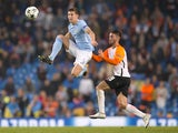 John Stones and Facundo Ferreyra in action during the Champions League game between Manchester City and Shakhtar Donetsk on September 26, 2017