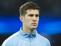 John Stones watches on ahead of the Champions League game between Manchester City and Shakhtar Donetsk on September 26, 2017