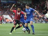 Bournemouth attacker Josh King is challenged by Leicester City's Harry Maguire during their Premier League clash at the Vitality Stadium on September 30, 2017