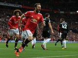 Manchester United midfielder Juan Mata wheels away in celebration after opening the scoring during the Premier League clash with Crystal Palace at Old Trafford on September 30, 2017