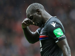 Crystal Palace defender Mamadou Sakho reacts after seeing his side concede during their Premier League clash with Manchester United at Old Trafford on September 30, 2017