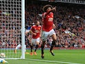 Manchester United midfielder Marouane Fellaini celebrates after doubling his side's lead during the Premier League match with Crystal Palace on September 30, 2017