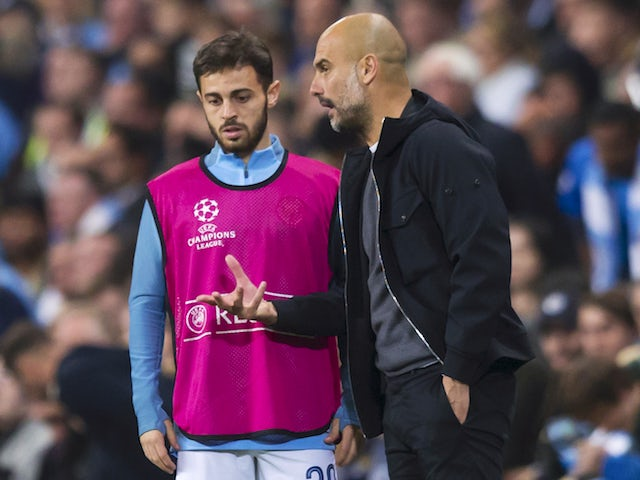 Pep Guardiola has a chat with Bernardo Silva during the Champions League game between Manchester City and Shakhtar Donetsk on September 26, 2017