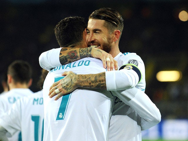 Sergio Ramos embraces Cristiano Ronaldo during the Champions League game between Borussia Dortmund and Real Madrid on September 26, 2017