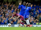 Tiemoue Bakayoko and N'Golo Kante deny all knowledge as Raheem Sterling goes down during the Premier League game between Chelsea and Manchester City on September 30, 2017