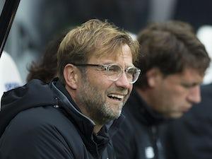 Liverpool thrash Brighton to go fourth