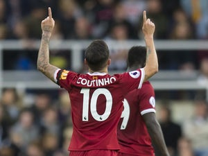 Liverpool run riot to clinch top spot
