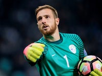 Jan Oblak in action for Slovenia during a World Cup qualifier with England