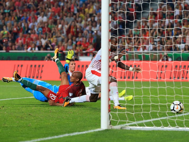 The first goal goes over the line during the World Cup qualifier between Portugal and Switzerland on October 10, 2017