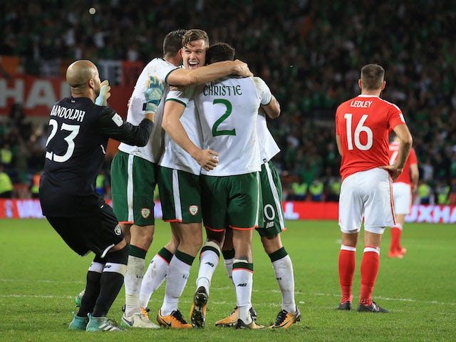 Irish players celebrate next to a dejected Joe Ledley after the World Cup qualifier between Wales and the Republic of Ireland on October 9, 2017