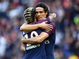Neymar and Edinson Cavani embrace during the Ligue 1 game between Paris Saint-Germain and Bordeaux on September 30, 2017