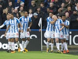 Aaron Mooy celebrates scoring during the Premier League game between Huddersfield Town and Manchester United on October 21, 2017