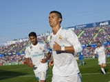 Cristiano Ronaldo celebrates scoring during the La Liga game between Getafe and Real Madrid on October 14, 2017