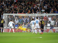 Cristiano Ronaldo scores from the spot during the Champions League group game between Real Madrid and Tottenham Hotspur on October 17, 2017