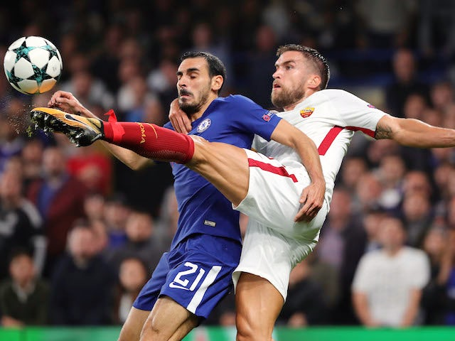 Davide Zappacosta plays air guitar with Kevin Strootman during the Champions League group game between Chelsea and Roma on October 18, 2017