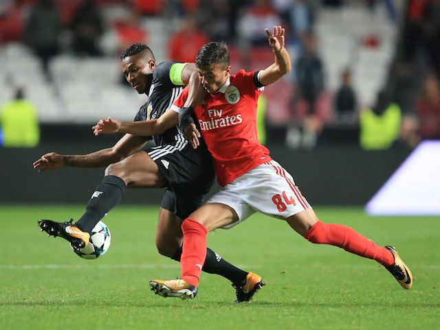 Diogo Goncalves and Antonio Valencia in action during the Champions League group game between Benfica and Manchester United on October 18, 2017