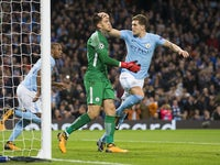 John Stones pats Ederson on the head after he saves a penalty during the Champions League group game between Manchester City and Napoli on October 17, 2017