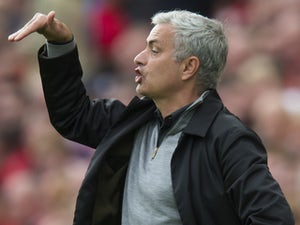 Jose Mourinho is bent out of all recognition during the Premier League game between Liverpool and Manchester United on October 14, 2017