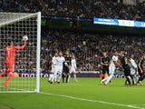 Keylor Navas saves Harry Kane's header during the Champions League group game between Real Madrid and Tottenham Hotspur on October 17, 2017