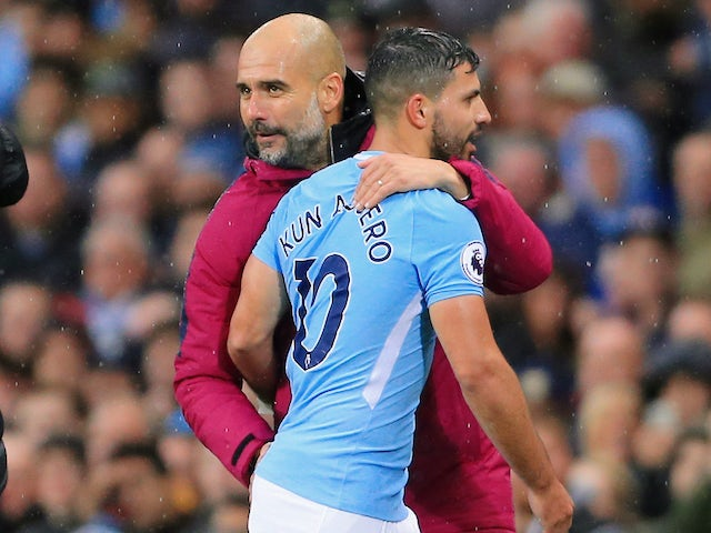 Pep Guardiola embraces Sergio Aguero during the Premier League game between Manchester City and Burnley on October 21, 2017