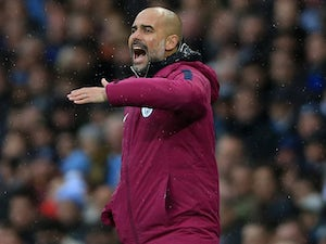 Pep Guardiola gesticulates during the Premier League game between Manchester City and Burnley on October 21, 2017