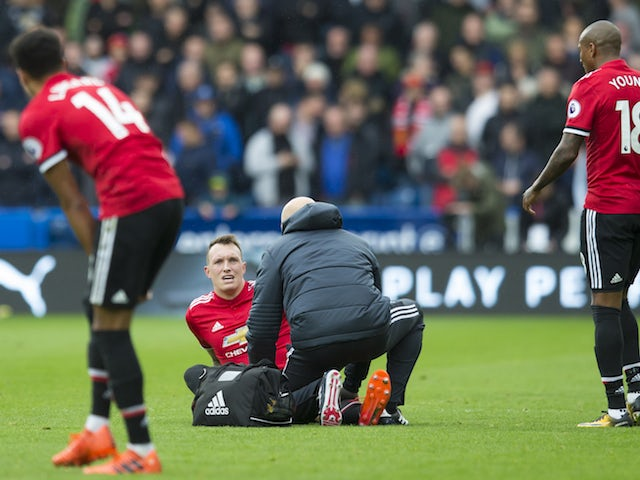 Phil Jones receives treatment during the Premier League game between Huddersfield Town and Manchester United on October 21, 2017