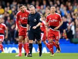 Hornets players complain to Jon Moss after Pedro nets the opener during the Premier League game between Chelsea and Watford on October 21, 2017