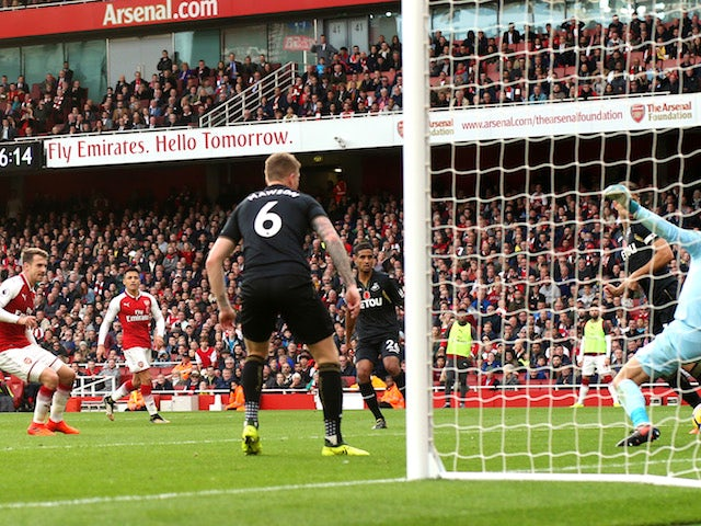 Aaron Ramsey scores during the Premier League game between Arsenal and Swansea City on October 28, 2017
