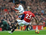 Antonio Valencia and Dele Alli in action during the Premier League game between Manchester United and Tottenham Hotspur on October 28, 2017