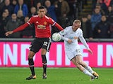 Chris Smalling does battle with Ollie McBurnie during the EFL Cup game between Swansea City and Manchester United on October 24, 2017