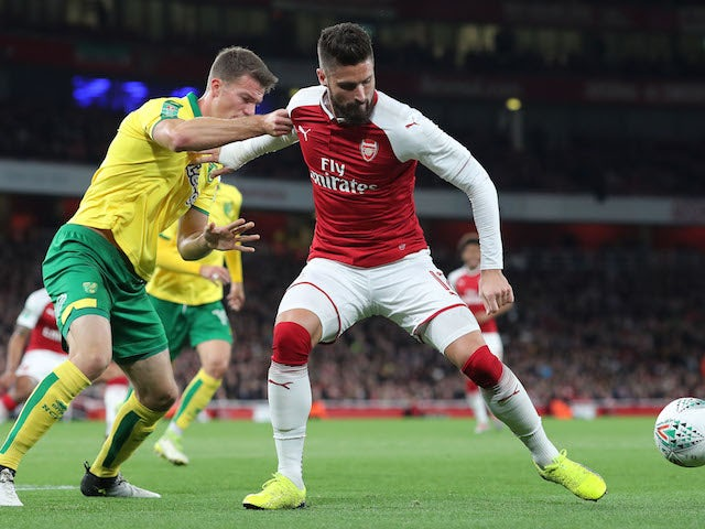 Christoph Zimmerman battles with Olivier Giroud during the EFL Cup game between Arsenal and Norwich City on October 24, 2017