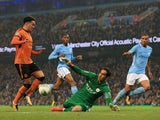 Claudio Bravo saves from Helder Costa during the EFL Cup game between Manchester City and Wolverhampton Wanderers on October 24, 2017