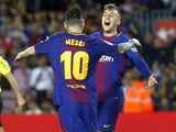 Gerard Deulofeu celebrates with Lionel Messi after scoring during the La Liga game between Barcelona and Malaga on October 21, 2017