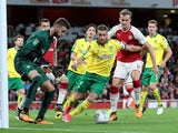 Ivo Pinto and Rob Holding in action during the EFL Cup game between Arsenal and Norwich City on October 24, 2017