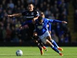John Terry and Isaac Vassell in action during the Championship game between Birmingham City and Aston Villa on October 29, 2017
