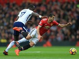 Moussa Sissoko and Henrikh Mkhitaryan in action during the Premier League game between Manchester United and Tottenham Hotspur on October 28, 2017