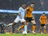 Raheem Sterling and Ruben Vinagre in action during the EFL Cup game between Manchester City and Wolverhampton Wanderers on October 24, 2017