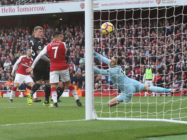 Sead Kolasinac scores the equaliser during the Premier League game between Arsenal and Swansea City on October 28, 2017