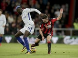 A blue-locked Tiemoue Bakayoko and Lewis Cook in action during the Premier League game between Bournemouth and Chelsea on October 28, 2017