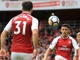 Alexis Sanchez plays to Arsenal teammate Sead Kolasinac on October 1, 2017